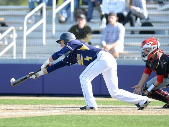 Elco center fielder Joe Ginder attempts to a sacrifice
