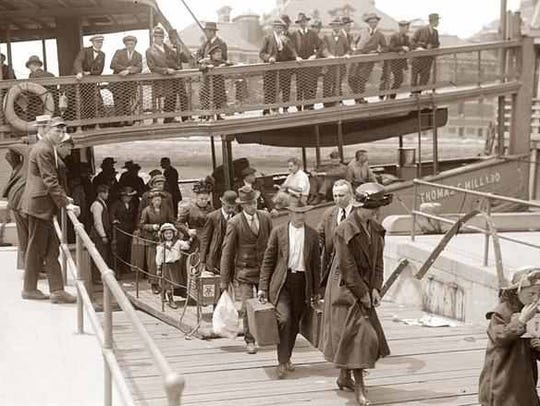 Immigrants arriving at Ellis Island after a long journey
