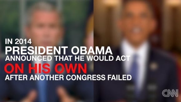 Screen grab of CNN video of George Bush and Barack Obama calling for immigration reform.