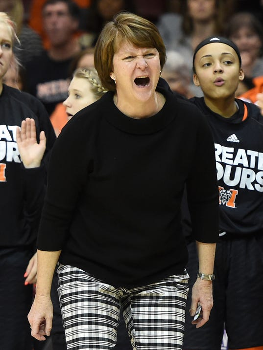 FILE - In this March 5, 2017, file photo, Mercer's head coach Susie Gardner reacts to a referee's call during the second half of an NCAA college basketball game against Chattanooga, in Asheville, N.C. Mercer is back in the AP Top 25 for the first time in 38 years. The Bears, riding a 24-game winning streak, entered The Associated Press women's basketball poll Monday, Feb. 26, 2018, at No. 25. It's the first time the team has been ranked since Dec. 9, 1980. (AP Photo/Kathy Kmonicek, File)