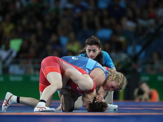 The United States' Helen Maroulis, right, wrestles defending gold medalist Saori Yoshida of Japan in the 53 kg finals Thursday in Brazil.