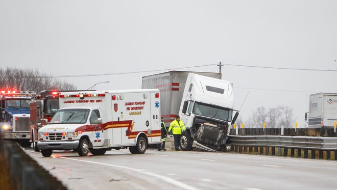 Emergency personnel are on scene where a  semi crashed into a guardrail Tuesday morning, April 4, 2017.  Westbound I-496 is closed near the Pennsylvania Street exit.