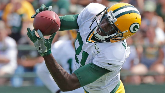 Green Bay Packers wide receiver Geronimo Allison (81) makes a stretching catch during Green Bay Packers training camp  August 15, 2016.