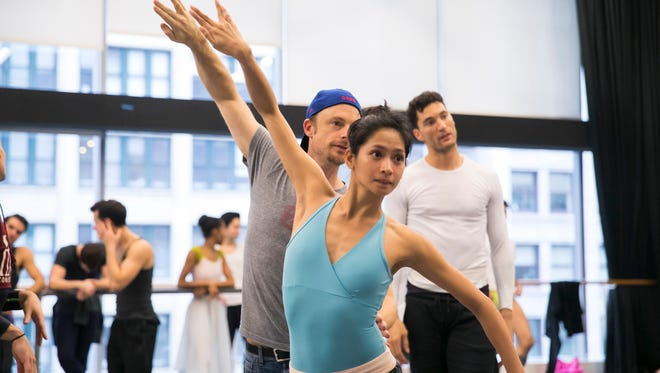 """Christine Rocas stands in front of Christopher Wheeldon as they practice a scene from Joffrey Ballet's new production of """"The Nutcracker."""""""