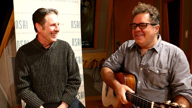 Andrew Farriss, right, talks to Bart Herbison about songwriting.