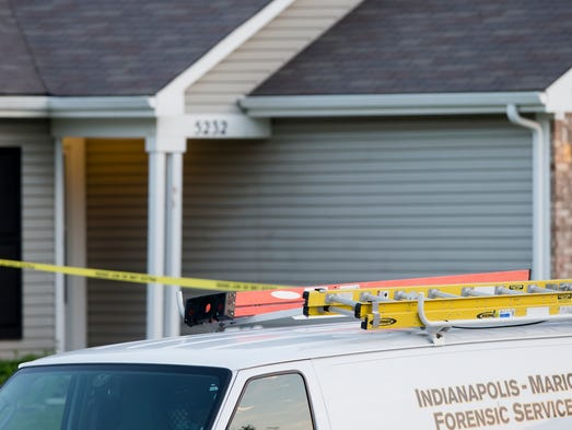 Scene of an overnight shooting that killed two and wounded three others on the 6000 block of Lakeside Manor Avenue, Indianapolis, Tuesday, May 20, 2014.