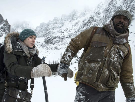 Kate Winslet and Idris Elba appear in a scene from