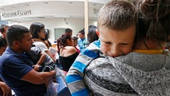 Migrant families are processed at the Central Bus Station