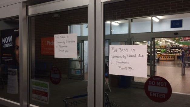 Signs warn customers that the Wal-Mart in Plainfield was closed Tuesday.