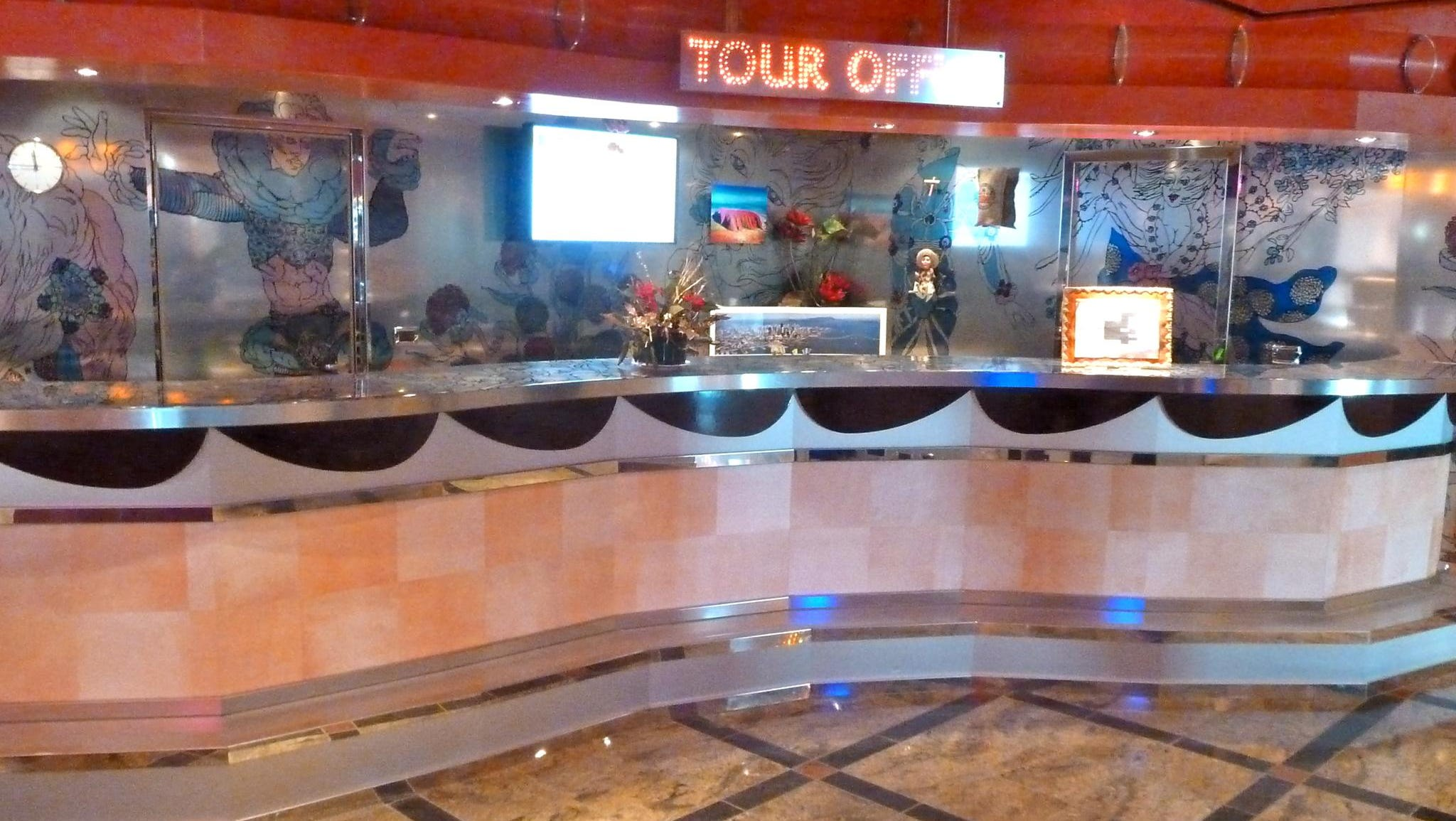 On the port side of the Atrio delle Delizie, there is a tour office, which is followed by the guest services desk.