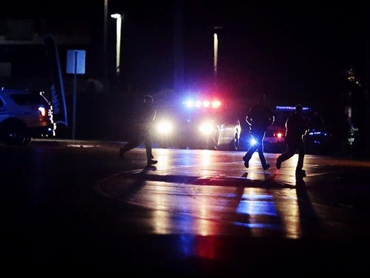 Authorities disperse from their posts during an investigation into the June 9 shooting in Landen.