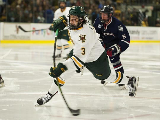 Catamount defenseman Mike Lee (3) takes a shot during the men's hockey game between the UConn Huskies and the Vermont Catamounts at Gutterson Field House on Friday night in Burlington.