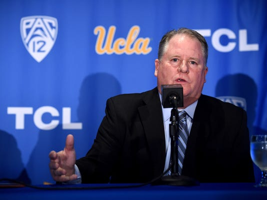 New UCLA head football coach Chip Kelly speaks during a news conference on the UCLA campus at Pauley Pavilion, Monday, Nov. 27, 2017. (Hans Gutknecht/Los Angeles Daily News via AP)