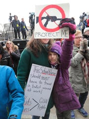 Gretchen Kuhnen, a Milwaukee Public Schools nurse, and her daughter Rita, 9, join thousands of students and adults at the March For Our Lives rally in Milwaukee on Saturday.