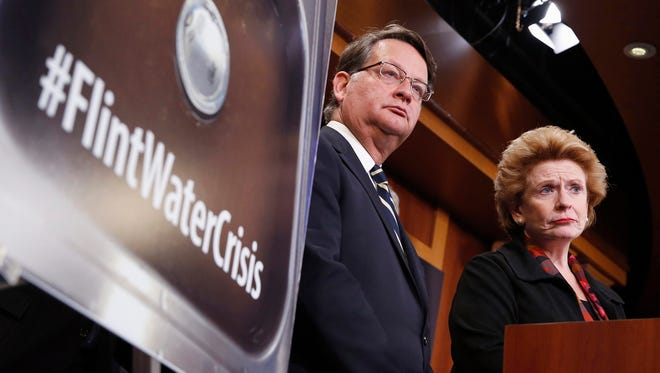 Sen. Gary Peters, D-Mich., left, and Sen. Debbie Stabenow, D-Mich., listen to a question as they discuss proposed legislation to help Flint with their current water crisis during a news conference on Capitol Hill in Washington in January 2016.