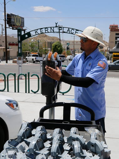 Chris Gamez of the International Bridge Park and Meter Department with the city of El Paso installs a parking meter mechanism Wednesday afternoon in the Kern Place area along Cincinnati Street. City officials announced that the meters will be functioning Aug. 1 and have given a two-week grace period to allow patrons to get used to the new meters. The city installed 122 parking meters at various locations within the newly created Uptown Parking Benefit District in Kern Place.