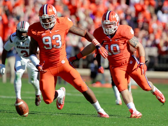 Clemson defensive end Corey Crawford (93) and linebacker Ben Boulware (10) run for a ball fumbled by South Carolina quarterback Dylan Thompson during Clemson's 2014 game against the Gamecocks at Memorial Stadium.