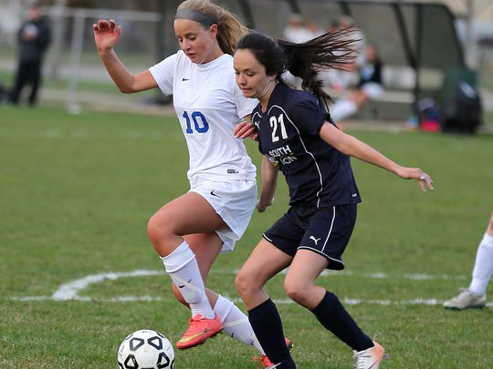 Going for a 50/50 ball Tuesday are Salem's Hailey Katulski (No. 10) and South Lyon's Emily Hudgens.