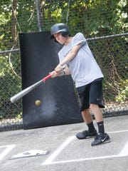 Mike O'Malley, 16, of New City, takes some swings at