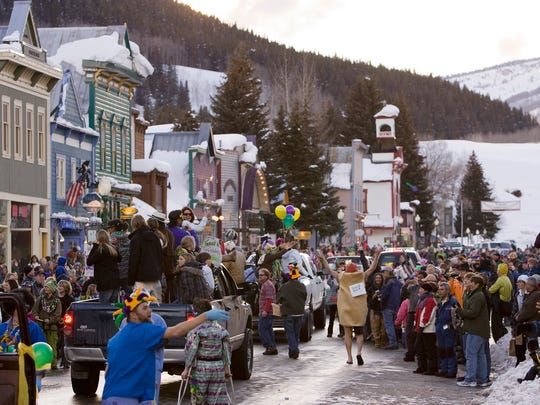 A crowd gathers on Elk Avenue in Crested Butte, Colo., during a Mardi Gras parade celebration in 2009.