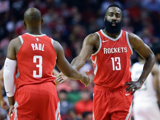 Houston Rockets guard James Harden (13) shakes hands with Chris Paul after a foul during the first half of an NBA basketball game against the Milwaukee Bucks, Saturday, Dec. 16, 2017, in Houston. (AP Photo/Eric Christian Smith)