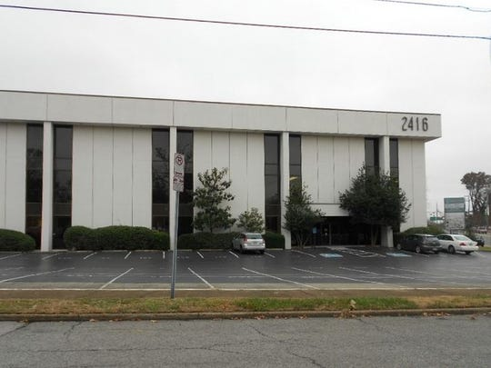 This three-story nearly 47,000 square foot building