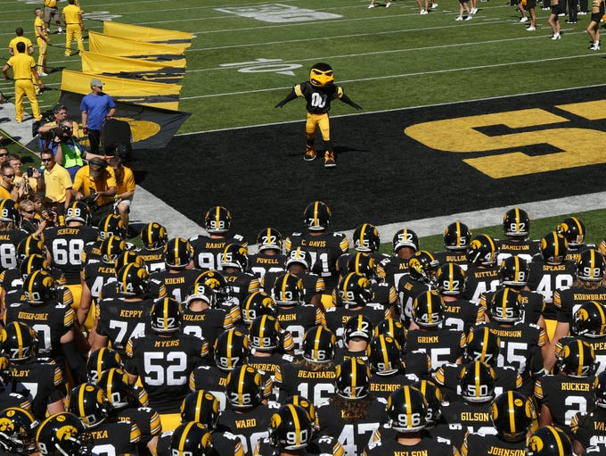 Herky waits for the Hawkeye football team to take the field against Ball State on Saturday, Sept. 6, 2014, at Kinnick Stadium in Iowa City, Iowa.