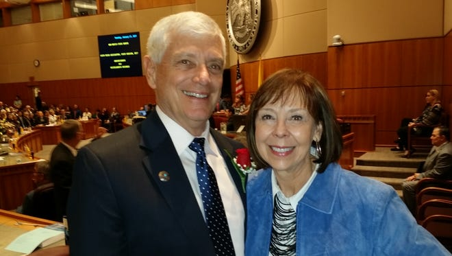 Sen. Ron Griggs and his wif Joan stand in the New Mexico Senate after Ron took the oath of office for the 2017 Legislative session.