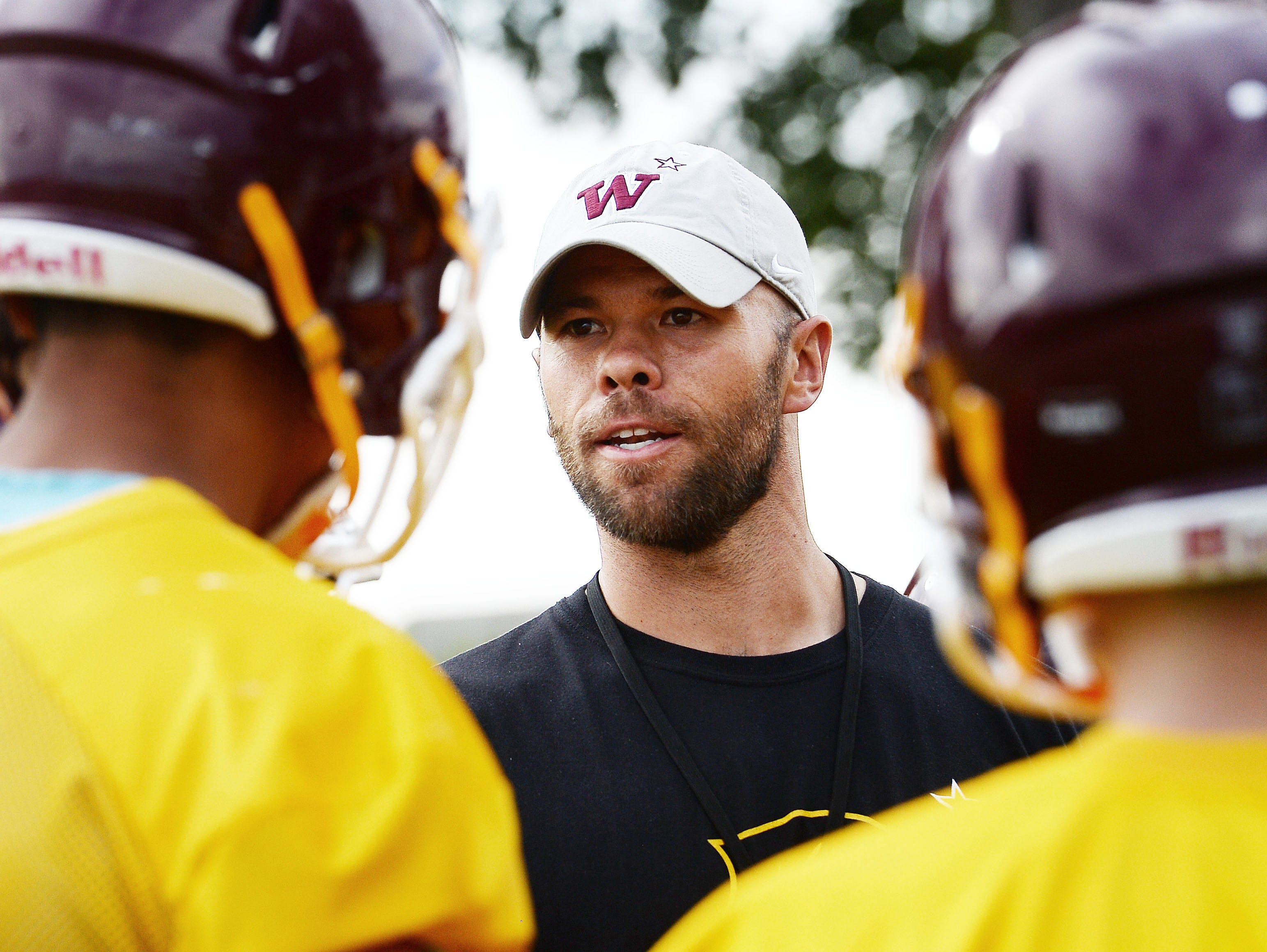 Windsor interim head coach Skylar Brower oversees the Wizards' first football practice of the season Aug. 15. He's replacing Chris Jones, who led Windsor to two state championships in five years, including in 2015.