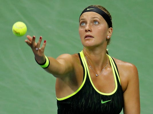 Petra Kvitova, of the Czech Republic, serves to Angelique Kerber, of Germany, during the fourth round of the U.S. Open tennis tournament, Sunday, Sept. 4, 2016, in New York. (AP Photo/Adam Hunger)