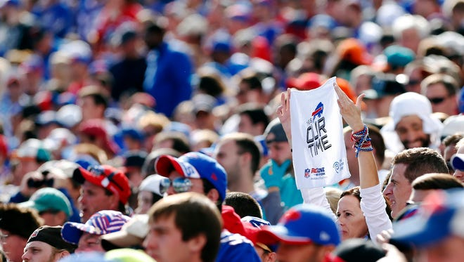 Bills fans show support for their team during the second half of the game between the Buffalo Bills and the Miami Dolphins at Ralph Wilson Stadium.
