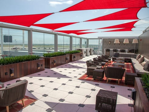 Delta's new Sky Club in Terminal Four features a unique outdoor terrace known as the Sky Deck with excellent views of the runway and a global collection of airlines passing by.