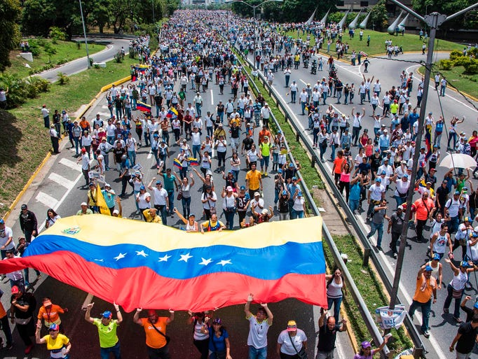 Thousands of people rally against Venezuelan President