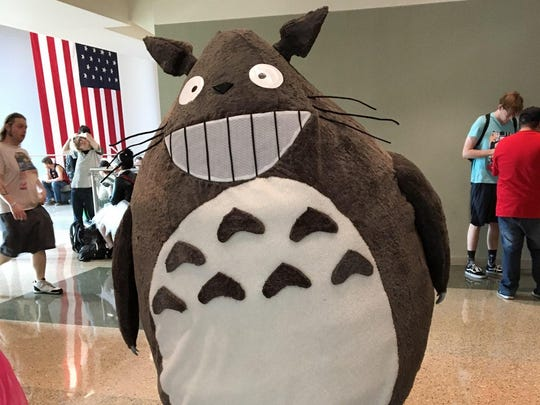 Jesse Young of Tucson is dressed in a larger-than-life Totoro costume during Day 3 of Phoenix Comic Fest Saturday, May 26, 2018.