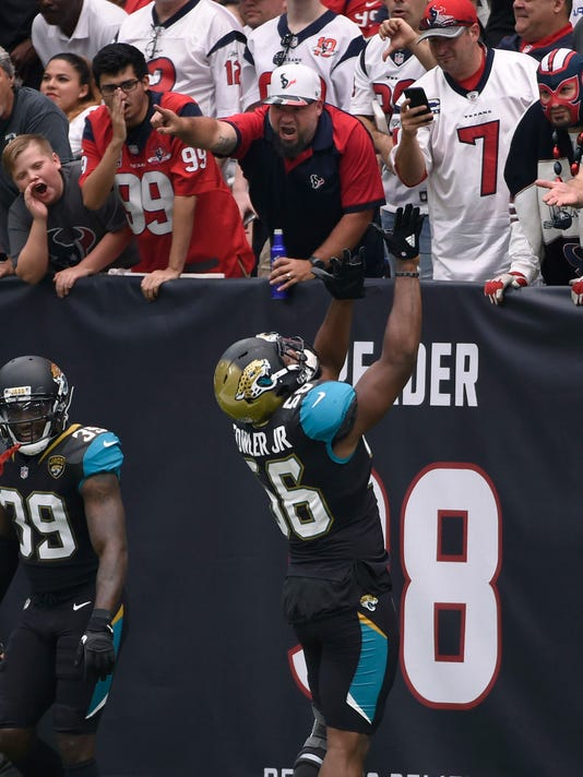 Jacksonville Jaguars defensive end Dante Fowler (56) celebrates his touchdown during the first half of an NFL football game against the Houston Texans, Sunday, Sept. 10, 2017, in Houston. (AP Photo/Eric Christian Smith)