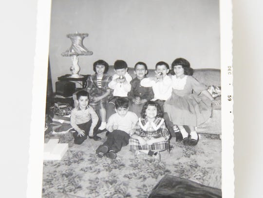 Fifty-five years after Guy Call arrived in America to mine coal as a child his grandchildren celebrate Christmas at his home.