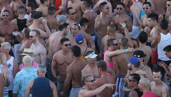 Thousands of men and a few women enjoy the party atmosphere during the White Party in Palm Springs, Sunday, April 27, 2014.