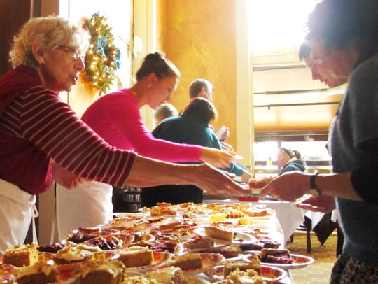 In full swing at the pie table: Anna Deller, 80, of
