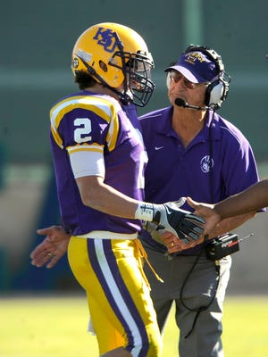 Hardin-Simmons wide receiver Mychal Carrillo (2) is congratulated as he comes off the field by coach Jimmie Keeling during the fourth quarter of the Cowboys' 55-10 win over Sul Ross State Saturday, Oct. 25, 2008, at HSU's Shelton Stadium.