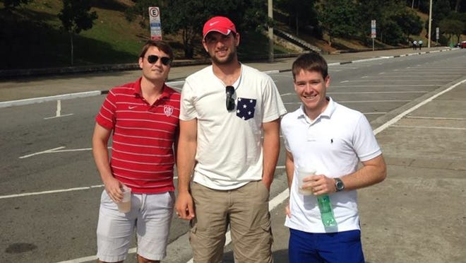 Colts QB Andrew Luck poses with fans in Brazil.