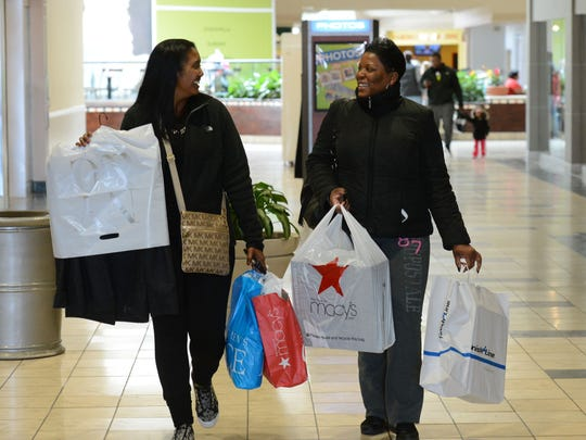 Kendra Dickerson, left, of New Castle, Delaware and Kesha Morton of Berlin leave The Centre at Salisbury after having a successful shopping day at the mall Friday.