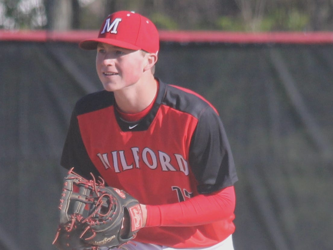 Milford senior Justin Arnold, shown here at first base, was two infield hits away from throwing back-to-back no-hitters.