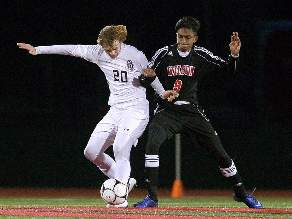 HF-L's Brian Teel. left, fights for possession against Wilson's Anoj Sharma during the Section V Class A2 final played at Hilton High School on Oct. 28, 2016.