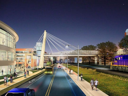 The University of Memphis is about to start construction on a land bridge, a parking garage, amphitheaters and plazas.