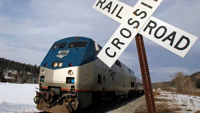 The Amtrak Vermonter heads down the track March 11, 2013, in Berlin, Vt.