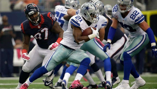 Asheville High alum Jeoffrey Pagan (97) is a defensive end for the Houston Texans.