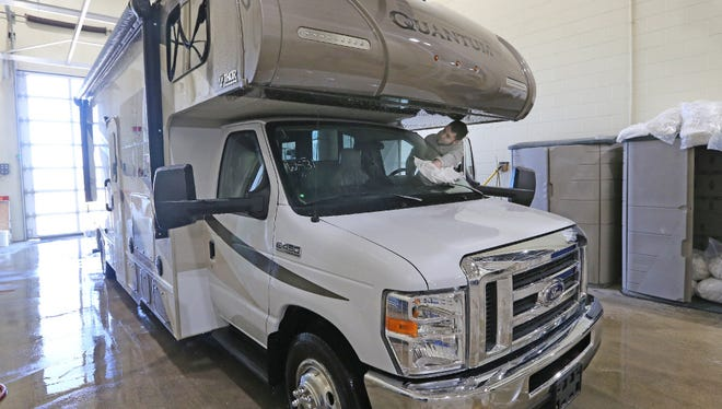 Josh Winkler finishes cleaning a motor home that is being readied for sale at the Burlington RV Superstore in Sturtevant. RV sales are strong headed into the warm weather travel season, dealers say.