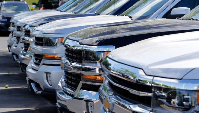 In this Wednesday, April 26, 2017, photo, Chevrolet trucks are lined up at a Chevrolet dealership in Richmond, Va. U.S. automobile sales declined in April.