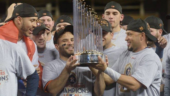 Nov 1, 2017; Los Angeles, CA, USA; Houston Astros second baseman Jose Altuve is presented the Commissioner's Trophy after defeating the Los Angeles Dodgers in game seven of the 2017 World Series at Dodger Stadium.