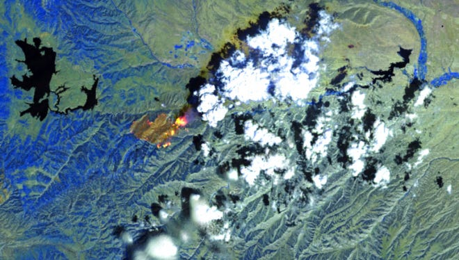 This image released by Descartes Labs shows its graphic image made infrared light readings of a wildfire also called the Dollar Ridge Fire near Duchesne, Utah. The base image is from a satellite of the National Oceanic and Atmospheric Administration. A new tool for visualizing and tracking wildfires from the sky was launched on twitter Wednesday, July 18, 2018, by the New Mexico-based startup company, in an effort that combines super-computing capabilities with satellite imagery.